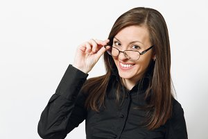 Beautiful happy caucasian young smiling brown-hair business woman in black classic shirt and glasses isolated on white background close up. Manager, worker, student. Copy space for advertisement.
