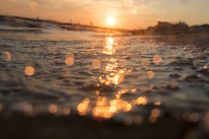 Beautiful sunrise over the tropical beach, blurred photo for background