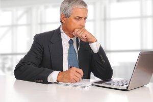 Mature Businessman Seated Laptop
