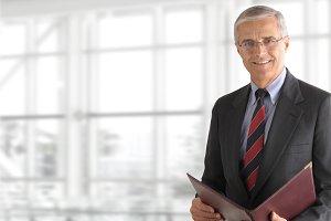 Mature Businessman Holding Folder