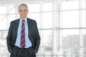 Mature Businessman Hands in Pockets
