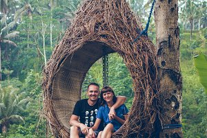 Traveler honeymoon couple in the jungle of Bali island, Indonesia. Couple in the rainforest.