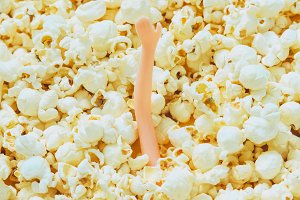doll girl's hand in popcorn