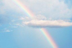 Rainbow on cloud and blue sky