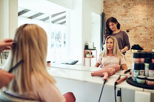 Woman looking at her new hairstyle in a salon mirror
