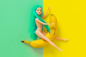 Doll rides on banana