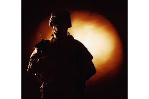 US marine silhouette on fiery background