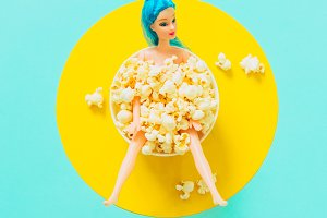 Doll in popcorn plate