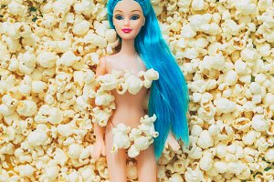 doll laying on popcorn
