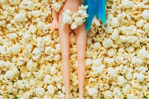 doll girl laying on popcorn