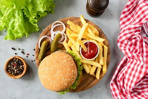 Burger with sesame, fries, pickles