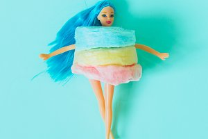 Doll in cotton candy dress