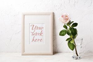 Wooden frame mockup with pink rose
