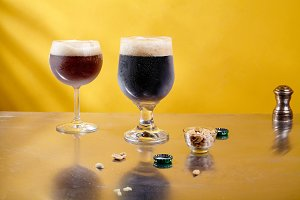 Ale and stout beer in glasses with snacks and sauce
