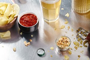 Ale, stout and lager beer in glasses with snacks and sauce
