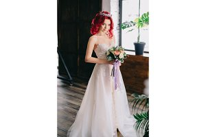 portrait of a young beautiful bride in a loft