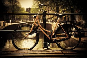 Romantic canal bridge, retro bike
