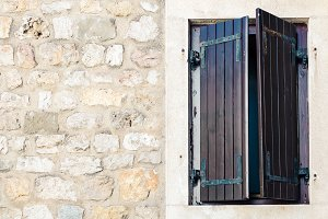 Wood window with closed shutters