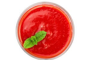 Tomato juice in glass with a mint leaf isolated on white background. Top view. Flat lay