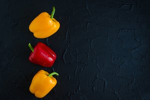 Orange yellow red bell peppers