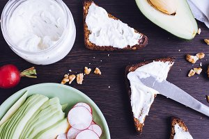 Sandwiches of rye bread with avocado and goat cheese