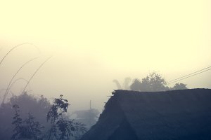 village among mountain and fog