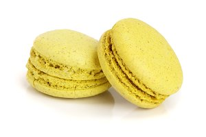 yellow macaroon isolated on white background closeup