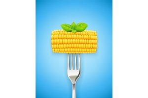 Corn cob at fork. Organic food.