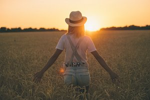 Happy Young woman in a wheat field