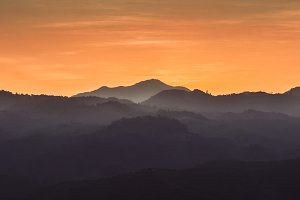 mountains among mist on sunset