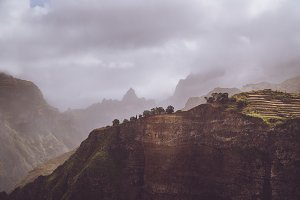 Scenery with shape of huge rocks and motion clouds mist on sky. Surreal moment before a thunderstorm in the mountains on Santo Antao Cape Verde