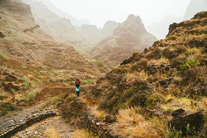 Traveler on great walking destination with stunning views of rugged coast lines and narrow canyons. Santo Antao Cape Verde Cabo Verde