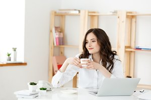 Woman Freelancer or business woman used Labtop working at modern office. Business and Technology concept