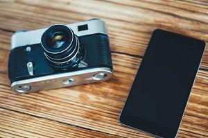 Vintage camera and modern smartphone
