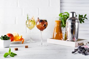 Two glasses with drink and Cocktail shaker for preparing a summer cocktail with a place for your subject and text