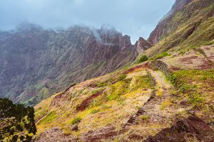 Rugged mountain range overgrown with verdant grass and encase by fog . Xo-Xo Valley. Santo Antao Island, Cape Verde Cabo Verde