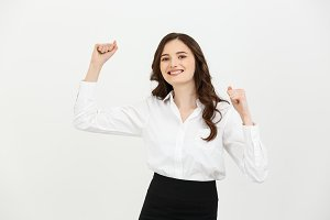Portrait of happy young caucasian businesswoman winning and showing hand on the air isolated over white