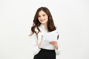 Business Concept: beautiful business woman write on paper or report. Isolated over white background.