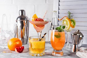 Refreshing summer cocktails with fruits and hot pepper, Bar accessories and fruits on white wooden backgorund