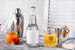 orange smoothies in the glass on wooden white background ,