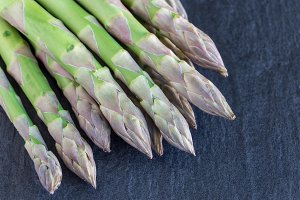 Green asparagus on dark background