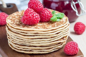 Stack of pancakes with raspberry