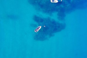 Aerial view of small boat in sea