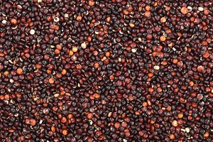 Black quinoa seeds as a background. Top view