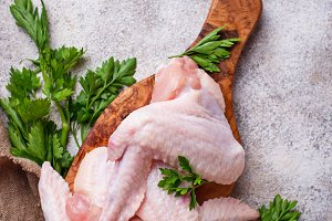 Raw chicken wings on cutting board