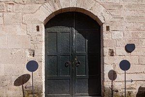 metal arched door
