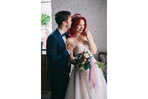 happy newlyweds hug and laugh, close-up