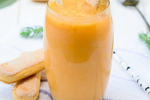 Glass of fresh cantaloupe smoothie
