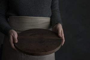 Woman holding a wooden tray