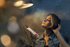 Girl listening to music on headphone